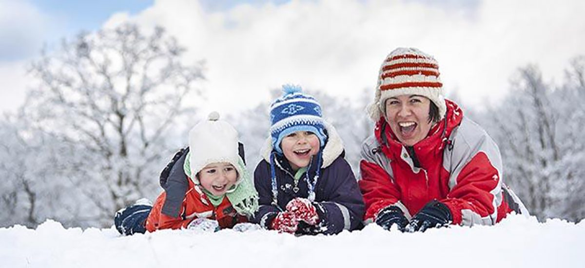 HiN Benefits, image of family in snow